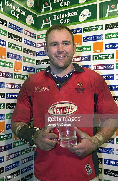 Scott Quinnell of Llanelli with his man of the match award during the Heineken Cup Pool 1 game between Llanelli and Leicester Tigers at Stradey Park,...