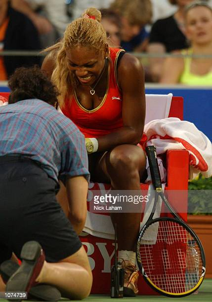 Serena Williams of the United States receives treament after injuring her right ankle during her semi final against Meghann Shaughnessy of United...