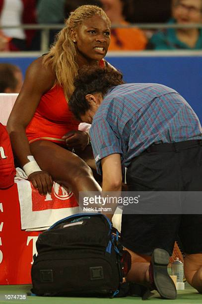 Serena Williams of the United States receives treatment after injuring her right ankle during her semi final against Meghann Shaughnessy of United...