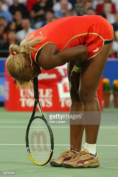 Serena Williams of the United States takes a moment after injuring her ankle during her semi final against Meghann Shaughnessy of United States...