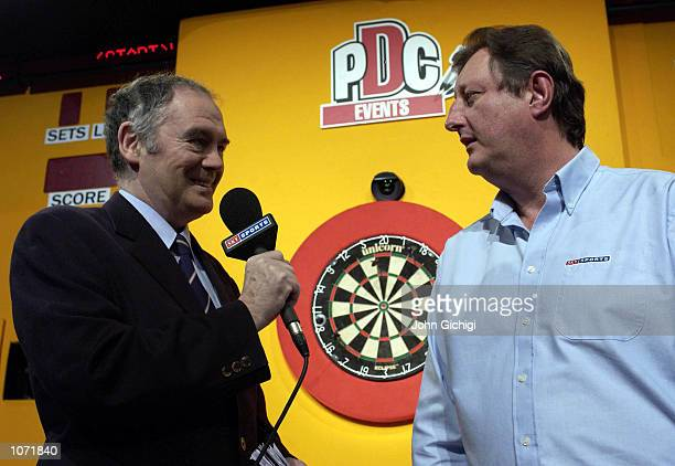 Sid Waddell the legendary darts commentator interviews Eric Bristow prior to the second round matches in the PDC Skol World Darts Championships at...