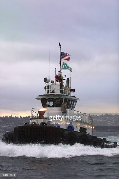 The Olympic Flame travels by tugboat across Puget Sound during the 2002 Salt Lake Olympic Torch Relay between Tacoma and Seattle Washington DIGITAL...
