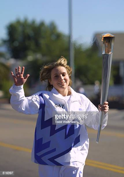 Torchbearer and Olympian Kerri Strugg carries the Olympic Flame during the 2002 Salt Lake Olympic Torch Relay in Tucson Arizona DIGITAL IMAGE...