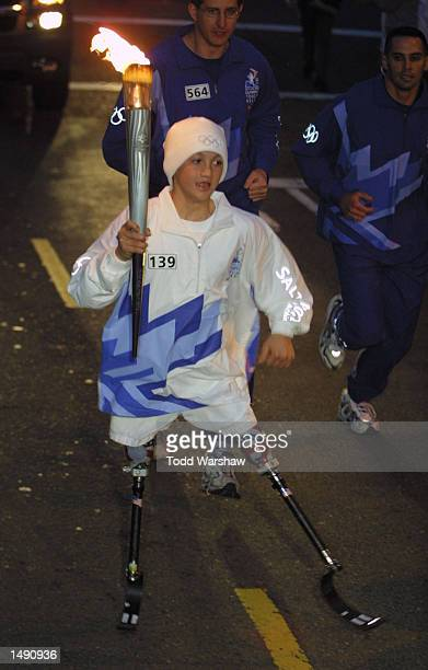 Torchbearer Rudy GarciaTolson carries the Olympic Flame during the 2002 Salt Lake Olympic Torch Relay in San Francisco California DIGITAL IMAGE...