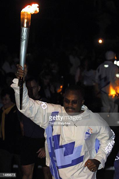 Torchbearer Tommy Smith carries the Olympic Flame during the 2002 Salt Lake Olympic Torch Relay in Santa Maria, California. DIGITAL IMAGE. Mandatory...