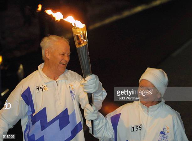 Torchbearers Gordie and Colleen Howe carry the Olympic Flame during the 2002 Salt Lake Olympic Torch Relay in Warren, Michigan. DIGITAL IMAGE....