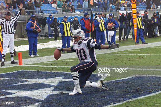 Troy Brown of the New England Patriots celebrates a touchdown on a punt return against the Carolina Panthers at Ericsson Stadium in Charlotte North...