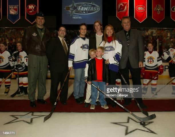 US Air Force Mjr Tim Harris NHL Group VP Frank Supovitz Scott Wolf Sean Flynn John Keach Kristopher Keach Jane Seymour and Phil Esposito pose after...