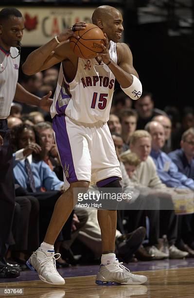 Vince Carter of the Toronto Raptors looks to pass during the game against the Orlando Magic at Air Canada Centre in Toronto Canada The Raptors won...
