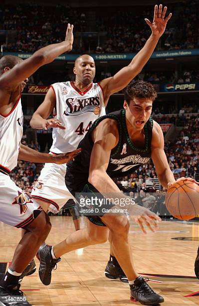Wally Szczerbiak of the Minnesota Timberwolves is surrounded by Derrick Coleman and Eric Snow of the Philadelphia 76ers at the First Union Center in...