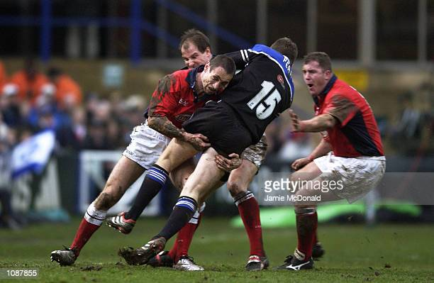 Wayne Proctor of Llanelli upends Matt Perry of Bath during the Heineken Cup quarter final game between Bath and Llanelli at the Recreation Ground in...