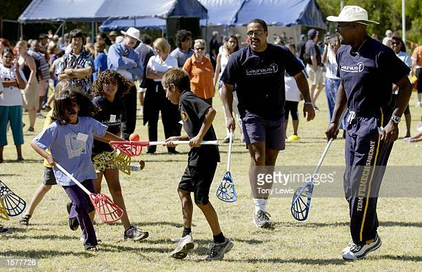 West Indian cricketer Sir Vivian Richards and British athlete Daley Thompson join in a game of lacrosse with schoolchildren at Kaurna Plains school...
