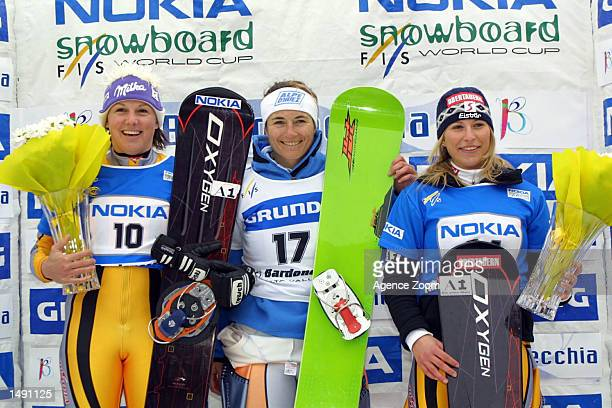 Winner Isabelle Blanc of FranceManuela Riegler of Austria and Heidi Krings of Austria celebrate on the podium after compieting in the women's giant...