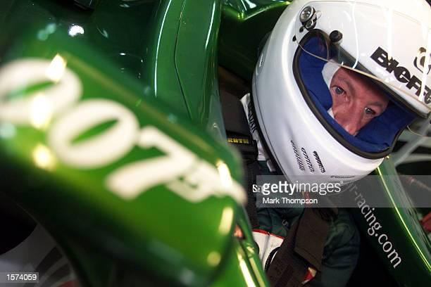 Wolfgang Reitzle, the chairman of Jaguar cars prepares to drive in the Jaguar R2 Formula one car the circuit Ricardo Tormo in Valencia, Spain....