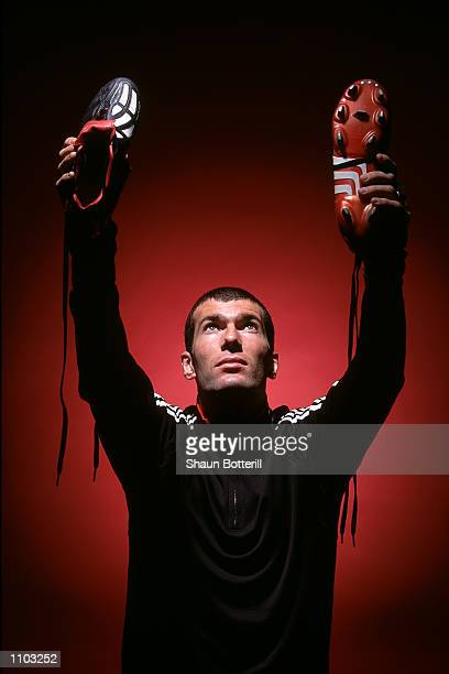 Zinedine Zidane of Real Madrid and France with the new Adidas Predator Mania football boots during a photoshoot in Oxford England Mandatory Credit...