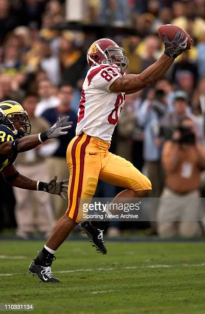 Keary Colbert of the USC Trojans catches a pass for a touchdown during the Trojans 2814 victory over the Michigan Wolverines in the Rose Bowl in...