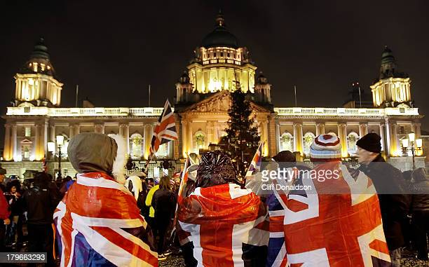 Protesters outside Belfast city hall to take part in a protest over restrictions on flying the Union flag at the building Picture Cliff Donaldson