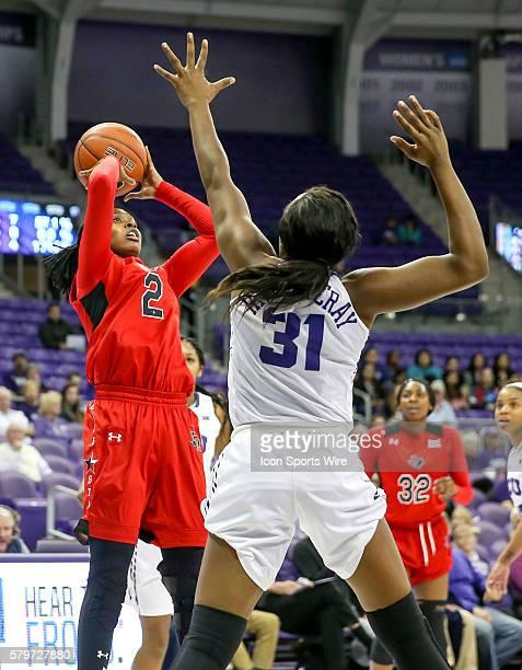 Texas Tech guard Ivonne Cook Taylor attempts a shot over TCU forward Destynee Hives-McCray during the NCAA Basketball game between the Texas Tech...