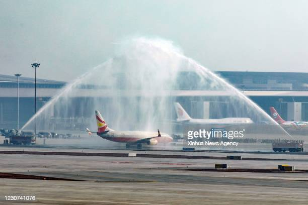 Jan. 22, 2021 -- A B737-800 airliner from the Lucky Air airlines taking part in the flight-test ceremony passes the water gate at the Chengdu Tianfu...