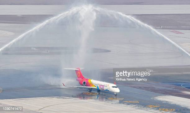 Jan. 22, 2021 -- An ARJ21 airliner from the Chengdu airlines taking part in the flight-test ceremony passes the water gate at the Chengdu Tianfu...