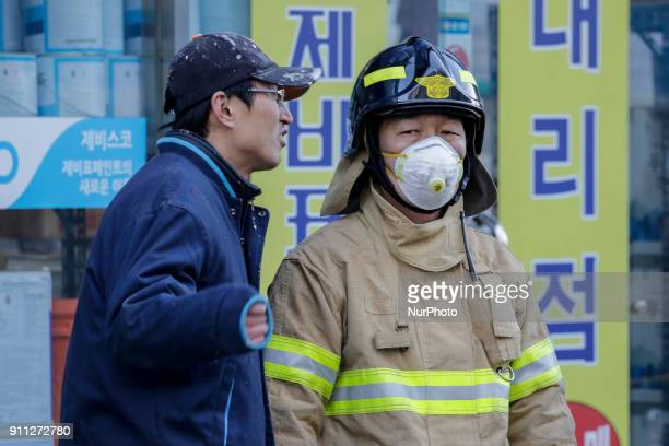 Jan 26 2018Miryang South KoreaSouth Korean Fire fighter hear from native about fired situation at near hospital in Miryang south Korea A fire gutted...