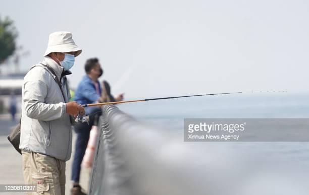 Jan. 26, 2021 -- A resident fish at a park in Sai Wan of south China's Hong Kong, Jan. 26, 2021. Hong Kong's Center for Health Protection CHP...