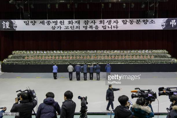 Jan 27 2018Miryang South KoreaMourners bow for victims at the South Korean Hospital Fire a Group Memorial Altar in Miryang South Korea A fire gutted...
