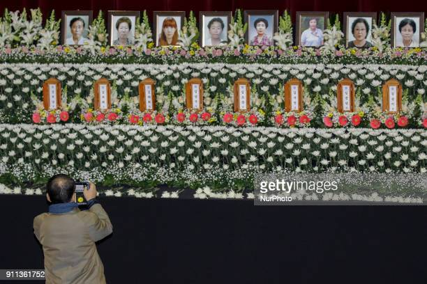 Jan 27 2018Miryang South KoreaMourners take picture after bow for victims at the South Korean Hospital Fire a Group Memorial Altar in Miryang South...