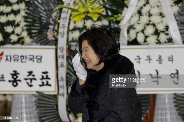 Jan 27 2018Miryang South KoreaMourners weep for victims at the South Korean Hospital Fire a Group Memorial Altar in Miryang South Korea A fire gutted...