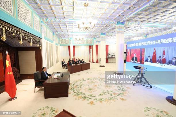 Jan. 27, 2021 -- Chinese Premier Li Keqiang hears a work report delivered via video link by Chief Executive of the Hong Kong Special Administrative...