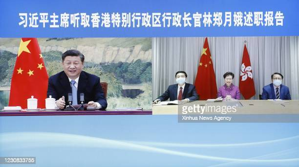 Jan. 27, 2021 -- Chinese President Xi Jinping hears a work report delivered via video link by Chief Executive of the Hong Kong Special Administrative...