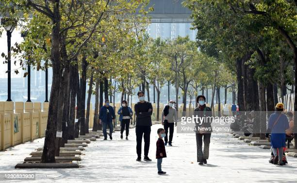Jan. 27, 2021 -- Citizens walk in a street in south China's Hong Kong, Jan. 27, 2021. Hong Kong's Center for Health Protection CHP reported 60...