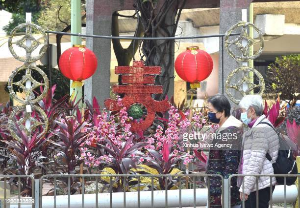 Jan. 27, 2021 -- Citizens wearing face masks are seen on a street in south China's Hong Kong, Jan. 27, 2021. Hong Kong's Center for Health Protection...