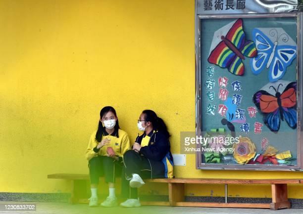 Jan. 27, 2021 -- Students talk at a school in south China's Hong Kong, Jan. 27, 2021. Hong Kong's Center for Health Protection CHP reported 60...