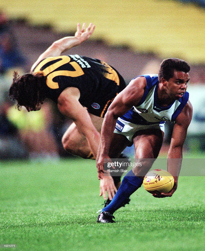 Winston Abraham of the Kangaroos gets away from Ben Harrison of Richmond, during the pre season Ansett Cup match between the Kangaroos and Richmond at Waverley Park, Melbourne, Australia. Mandatory Credit: Hamish Blair/ALLSPORT