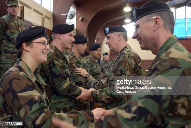 Jan. 3, 2003--Cambridge, MA.--Second lieutenant Jennifer Austin of Litchfield, Connecticut gets a warm good-bye from Comand Sergeant Major Richard...