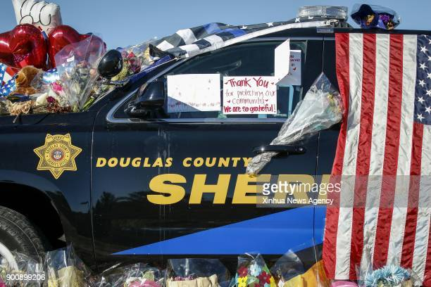 DENVER Jan 3 2018 Flowers and balloons on a police car are seen to mourn for Douglas County Sheriff's Deputy Zackari Parrish who was shot and killed...