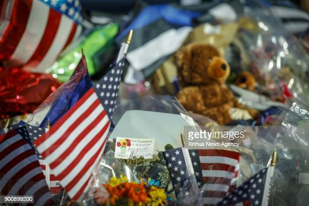 DENVER Jan 3 2018 Flowers and toys on a police car are seen to mourn for Douglas County Sheriff's Deputy Zackari Parrish who was shot and killed in...