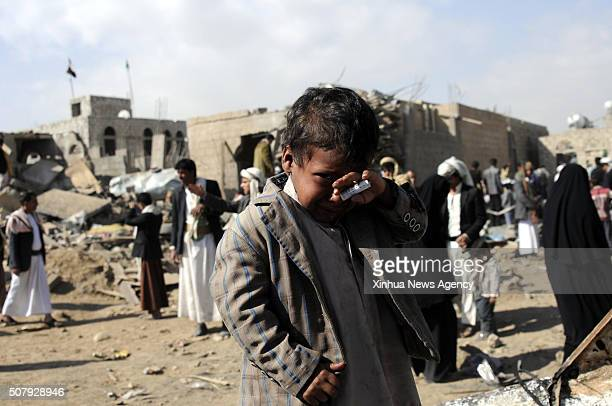 SANAA Jan 31 2016 A boy cries near the houses destroyed in airstrikes carried out by the Saudiled coalition in Sanaa Yemen on Jan 31 2016 An...
