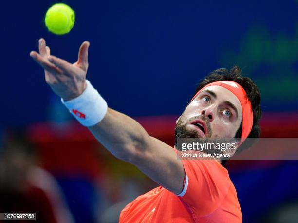 DOHA Jan 4 2019 Nikoloz Basilashvili of Georgia serves the ball during the singles quarterfinal match against Novak Djokovic of Serbia at the ATP...