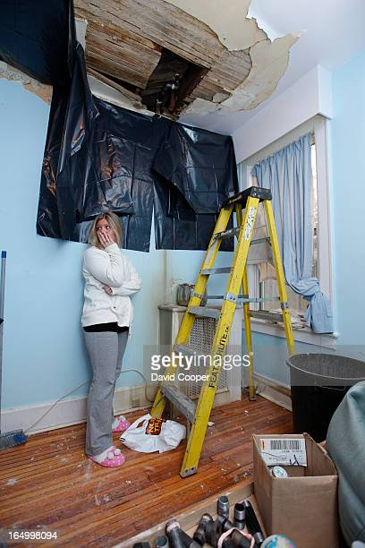 Jan 5 2010 Sabrina Jackson looks away after surveying the damage caused by leaking water in her nineyearold son room at 9 Balsam Ave