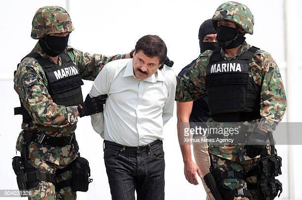 "Jan. 8, 2016 -- File photo taken on Feb. 22, 2014 shows members of Mexican Navy guarding Joaquin Guzman Loera, center, alias ""El Chapo"", during his..."