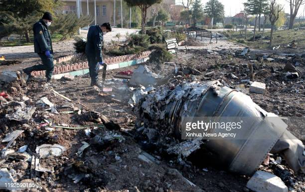 TEHRAN Jan 8 2020 Rescuers work at the air crash site of a Boeing 737 Ukrainian passenger plane in Parand district southern Tehran Iran on Jan 8 2020...