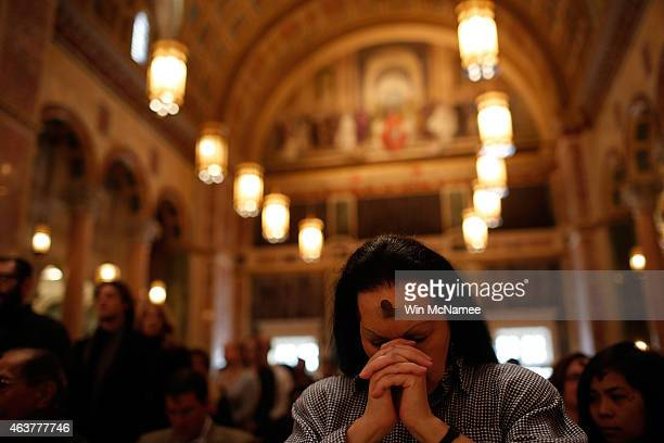 Jan Ali prays during Ash Wednesday Mass at the Cathedral of St Matthew the Apostle February 18 2015 in Washington DC On Ash Wednesday Catholics...