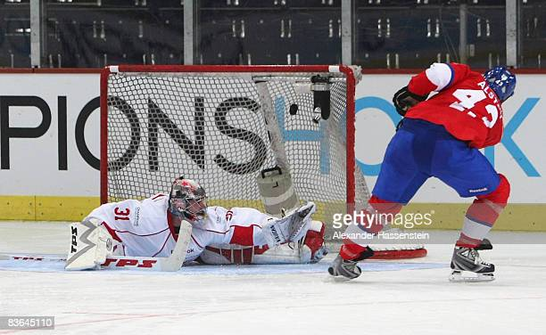 Jan Alston of Zurich scores a goal during the penalty shot out of the IIHF Champions League Group D match between ZSC Lions Zurich and Slavia Prague...