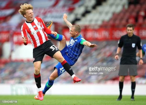 Jan Žambůrek of Brentford FC is fouled by Joe Garner of Wigan Athletic resulting in a red card during the Sky Bet Championship match between...