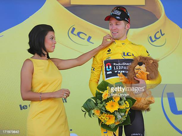 Jan Bakelants of Belgium and Radioshack Leopard celebrates on the podium as he wears the yellow jersey after winning stage two of the 2013 Tour de...