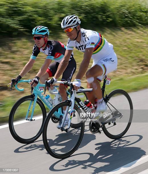 Jan Bakelants of Belgium and Radioshack Leopard chats with Phillipe Gilbert of Belgium and BMC Racing Team during stage thirteen of the 2013 Tour de...