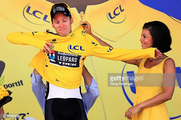 Jan Bakelants of Belgium riding for Radioshack Leopard takes to the podium after he defended the overall race leader's yellow jersey in stage three...