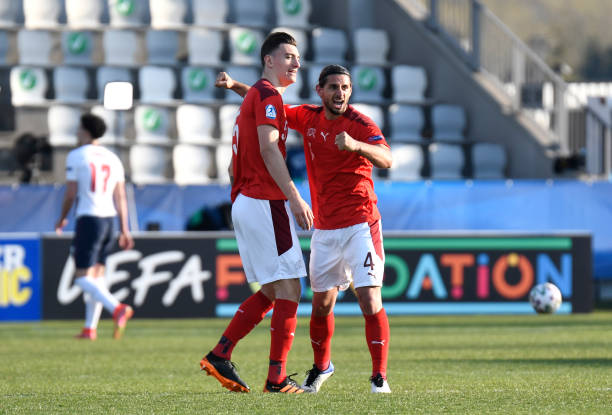 Jan Bamert and Cedric Zesiger of Switzerland celebrate at full time during the 2021 UEFA European Under-21 Championship Group D match between England...